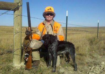 Lynda with TopperLyn Jette's first pheasant